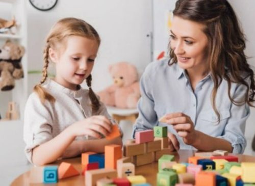 depositphotos_223480018-stock-photo-happy-mother-playing-blocks-adorable